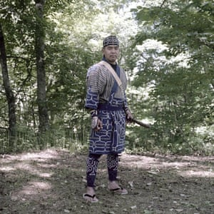 Taichi Kaizawa, traditional Ainu dancer, by the Saru river.