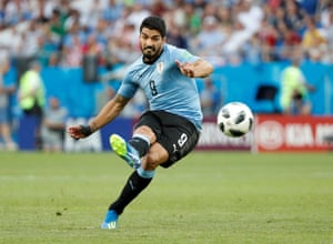 Uruguay's Luis Suarez shoots at goal from a free-kick