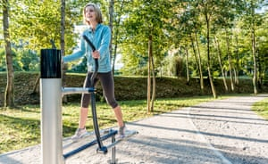Woman Using Exercise Bike in Public Park