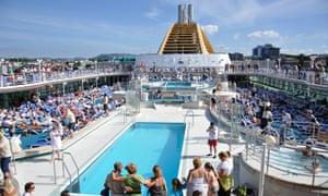 Passengers on the sundeck of P&O's Oceana off Stavanger,