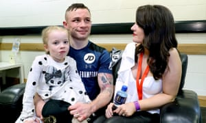 Carl Frampton joins his wife Christine and daughter Carla after beating Horacio Garcia in November.