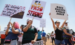 Demonstrators stand at a protest against Trump's visit in El Paso, Texas Wednesday.