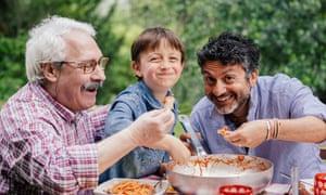The Mediterranean ideal: three generations enjoy an Italian meal.