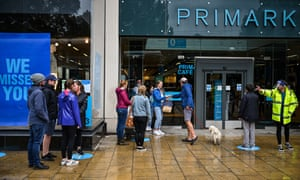 Shoppers queue while observing physical distancing guidelines outside Primark on Princess Street, Edinburgh.