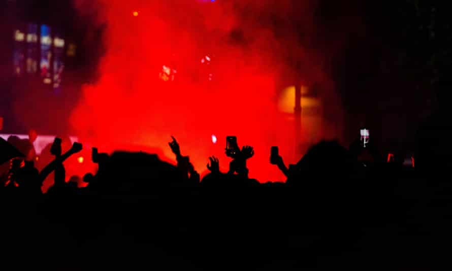 Scotland fans let off flares in Leicester Square after the England match.