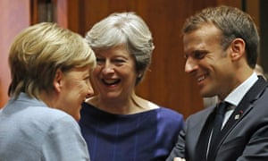 Angela Merkel (left), Theresa May and Emmanuel Macron at the EU summit.