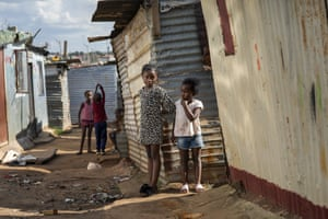 Children play in the Empiweni settlement near Soweto