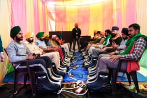 Farmers enjoy feet massages in a tent erected at the Delhi-Haryana state border
