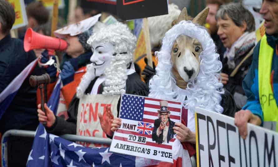 Julian Assange's supporters protest in front of Woolwich crown court in London on Monday.