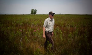 David Lucas, US Fish and Wildlife manager of the Rocky Flats National Wildlife Refuge, walks through a field on the property.