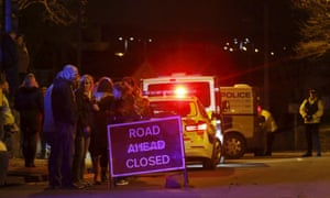 Evacuated residents and emergency personnel are seen at the scene of a collapsed road bridge in Tadcaster.