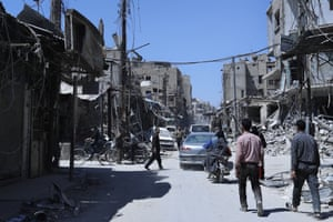 A street in the town of Douma, the site of a chemical weapons attack, near Damascus. Two days after Syrian troops declared Douma 'liberated' from opposition fighters, a supervised media tour of the city showed the widespread destruction it has suffered.