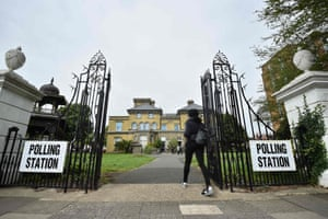 A woman arrives to cast her vote at the Hove Museum and Art Gallery near Brighton.