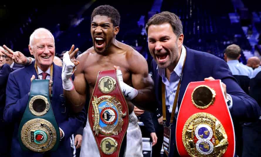 Barry Hearn and his son Eddie enjoy Anthony Joshua's world heavyweight title win over Andy Ruiz Jr in Saudi Arabia last December.