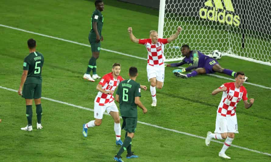 Croatia's players celebrate after Oghenekaro Etebo (second from left) puts them ahead with an own goal.