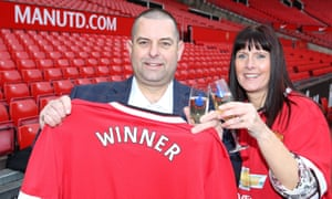 Sean Lloyd and his wife, Melanie, who won £1.8m. The bus driver said he would leave his job.