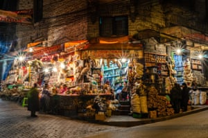 By Pawel Tatarek. The Witches' Market, La Paz, Bolivia. The photo shows a heavily stocked corner shop, its lights on, at night.