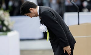 Japanese Prime Minister Shinzo Abe bows in front of the Peace Prayer statue in Nagasaki. It is expected he will include the word 'apology' in an anniversary statement later this week.