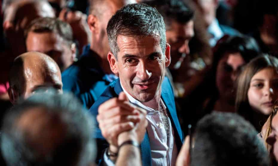 Kostas Bakoyannis celebrates with his supporters after his election victory