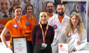 left to right, are as follows: Helen Richmond, Kathleen Elverson, Emily Xu – GSK Young Scientist of the Year, Andy Hunt, Alan Brooks and Judith Gregory. The two in orange (Helen and Kathleen) to the left of Emily, are Big Bang volunteers and the three in white (Andy, Alan and Judith) to Emily's right are GSK employees
