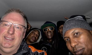 Kevin Wells takes a selfie with Public Enemy