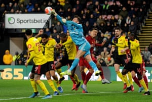 Watford keeper Ben Foster punches the ball clear.