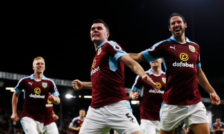 Keane celebrates with team-mates after scoring for Burnley against Watford last month.