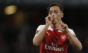Mesut Ozil celebrates scoring Arsenal's fourth goal.