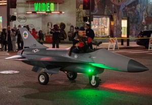 A model plane drives past