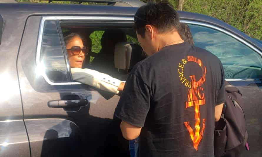 Former Prince drummer Sheila E reaches out to a fan as she leaves the Paisley Park complex in Minnesota on Saturday.