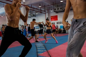 Huang Wensi spars during her final training session before she heads to Taiwan for her Asian female continental super flyweight championship fight.