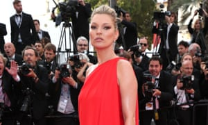 Loving the red carpet: Kate Moss wearing a vintage Halston gown.