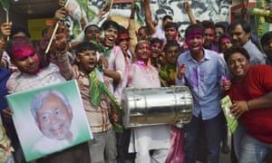 Supporters of the Janata Dal party celebrate after learning the initial election results in Patna, Bihar's capital