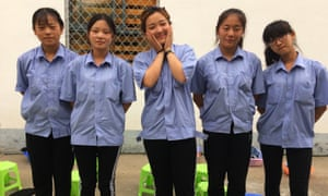 Bing Jiaying, centre, with fellow students, fears she will be at the boot camp for a whole year.