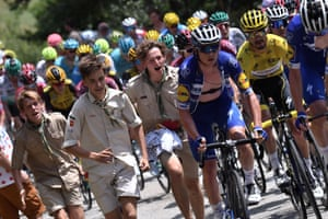 Stage 15 Limoux - Foix Prat d'Albis, 185km Enthusiastic scouts run alongside Julian Alaphilippe wearing the overall leader's yellow jersey