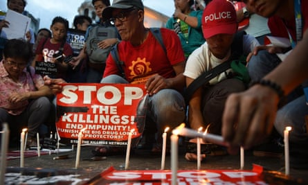Activists light candles outside a Manila church. The vigil was for victims of extra judicial killings carried out as the Philippines government pursues its war on drugs.
