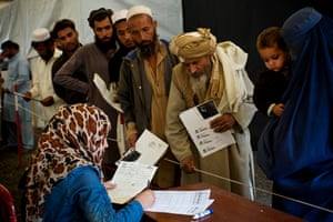 Afghan refugees, who have been forced to leave Pakistan and return to Afghanistan, register at a UNHCR reception centre on the outskirts of Kabul