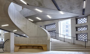 The sweeping spiral staircase and angled buttresses inside Herzog & de Meuron's Tate Modern Switch House