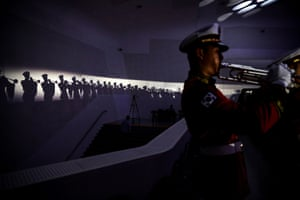 Members of a military band perform during a ceremony to commemorate the anniversary of the United Nations forces' participation in the Korean War.