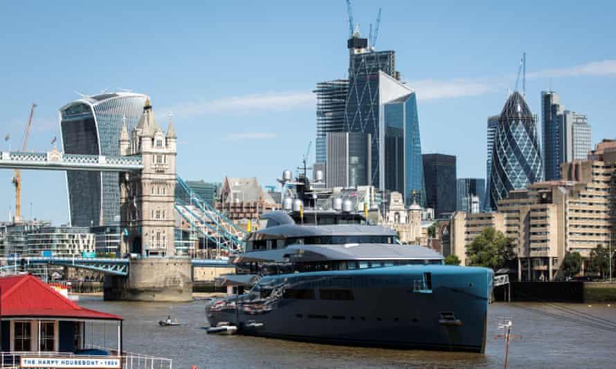 Aviva, the luxury yacht belonging to billionaire Tottenham Hotspur owner Joe Lewis, moors by Tower Bridge.