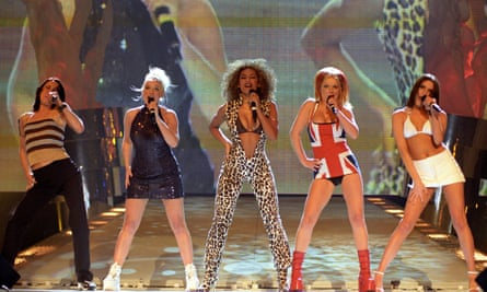 The Spice Girls perform on stage at the Brit Awards ceremony in 1997.