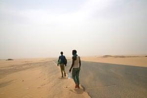 Ethiopian migrants walk beside a road in Yemen en route to Saudi Arabia, where they hope to find work