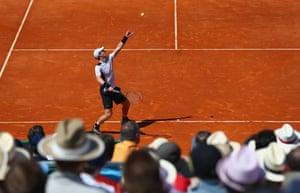 Murray serves against Nadal under blue skies in Monte Carlo.