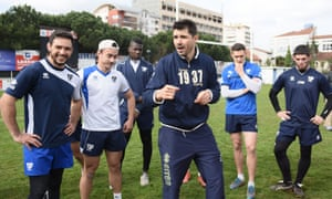 Toulouse Olympique coach Sylvain Houles addresses his players.