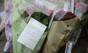 A note and flowers left by Labour MP Mary Creagh with other bouquets at a statue to Joseph Priestly in Birstall, where Jo Cox was shot dead.