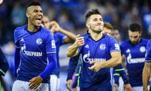 Schalke players celebrate their win over Mönchengladbach.