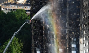 Firefighters dousing down the tower block after the tragedy