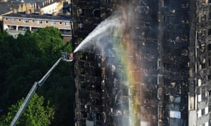 Firefighters spray water at Grenfell Tower in west London on 14 June.