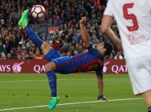 Barcelona's Luis Suarez acrobatically opens the scoring.