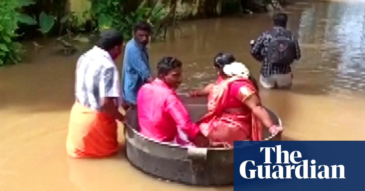 Indian couple float to wedding in cooking pot after floods in Kerala – video